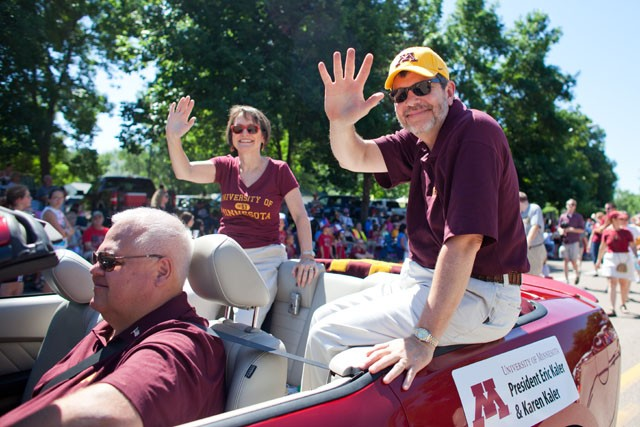 President Eric Kaler and his wife Karen join the University of Minnesota Marching Band at the Delano 4th of July Parade three days after Kaler takes the office as the 16th President of the University of Minnesota.