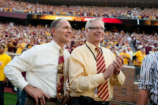 Athletics Director Joel Maturi stands next to former University of Minnesota President Robert Bruininks during the inaugural game at TCF Bank Stadium on September 12, 2009.