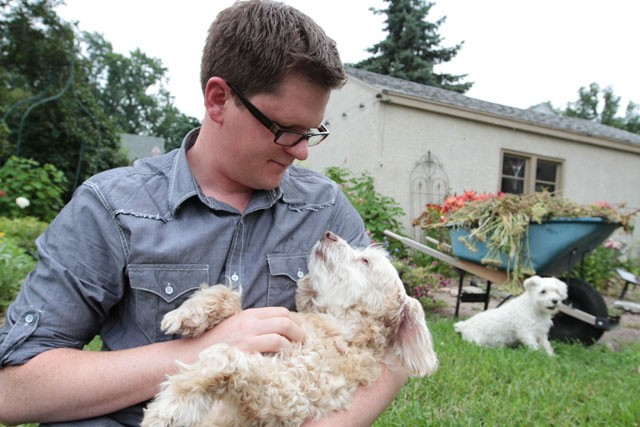 Chris Gauron holds his dog Doji Saturday at his home in Robbinsdale. Gauron brought Doji into the U of M Veterinary Medical Center in 2009 after he was bitten by a pit bull.