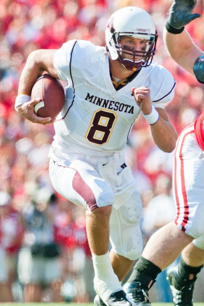 Senior quarterback Adam Weber runs the ball against Wisconsin Oct. 9 in Madison.