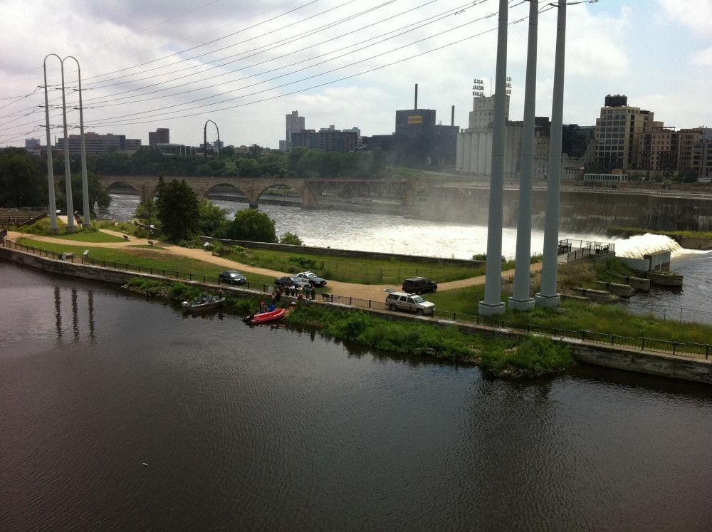 City police and county sheriffs worked to pull the body out of the Mississippi River on Wednesday afternoon.