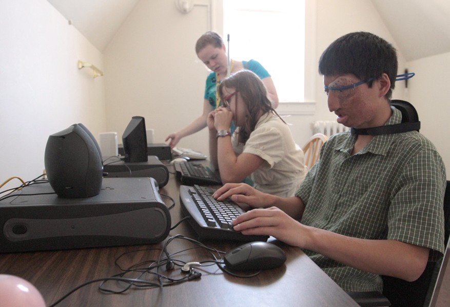 11-year-old Jamison Christopher, right, learns computer skills Thursday at the Pillsbury Mansion in South Minneapolis.  Instead of requiring a monitor, visually impaired children use an audio speaker that verbalizes their actions in order to keep track of their work.