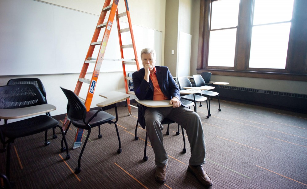 Associate Vice President of Captial Planning and Project Management Mike Perkins does his routine inspection Friday at Folwell Hall. After eight years managing construction at the University of Minnesota,  Perkins will retire in January.