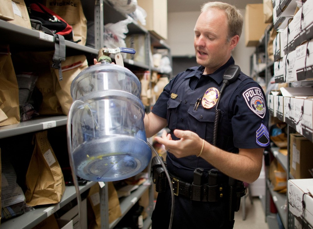 Sergeant Erik Stenemann shows the second most impressive bong that has been taken into the University of Minnesota Police Department's recovered property room. The recovered property room contains all of the evidences and properties surrendered to the UMPD