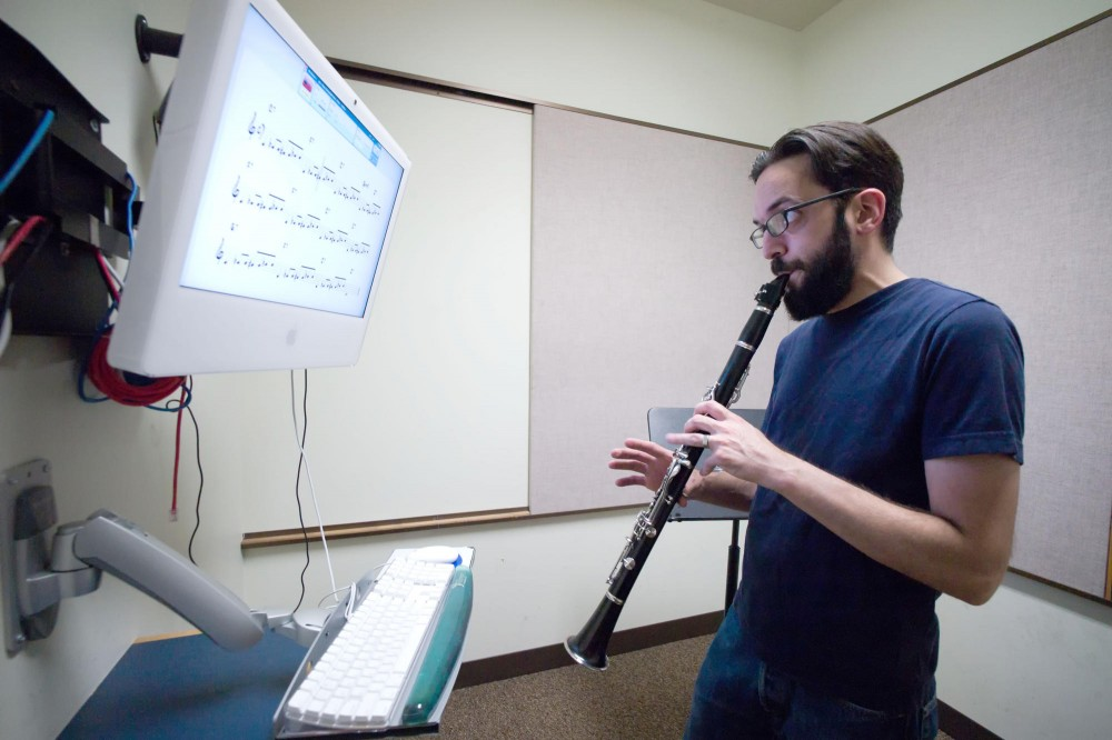 Music Technology, Media Lab and Studios Specialist Michael Duffy demonstrates SmartMusic software on Friday in Ferguson Hall.  Instructors are trying to find a balance in their use of technologies like SmartMusic, which automatically grade students' performances.