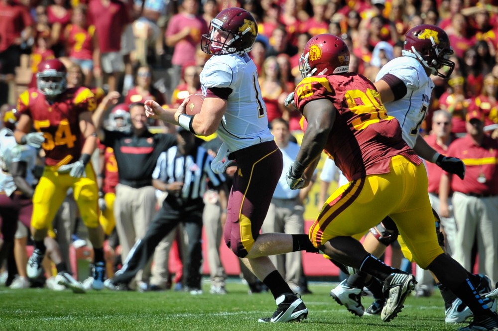 Minnesota freshman quarterback Max Shortell runs the ball Saturday in Los Angeles.  Shortell replaced Marqueis Gray after Gray left the game with leg cramps.