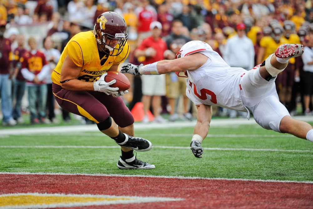 Gophers junior tight end John Rabe scores a touchdown against the Miami Red Hawks Saturday at TCF Bank Stadium.