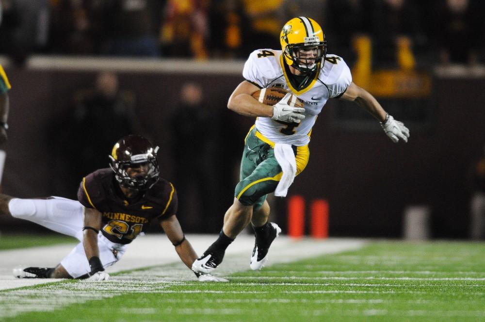 North Dakota State wide receiver Ryan Smith blows past Minnesota defensive back Brock Vereen Saturday at TCF Bank Stadium.
