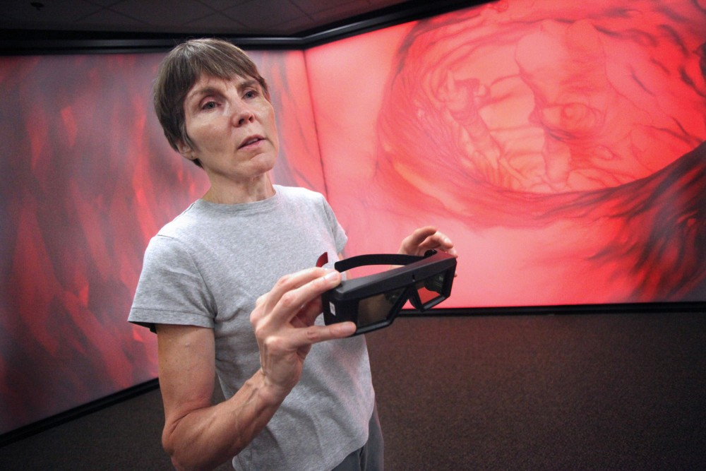Director Nancy Rowe explains how the 3D glasses work with motion tracking to create a simulation that changes perspective when the viewer moves.