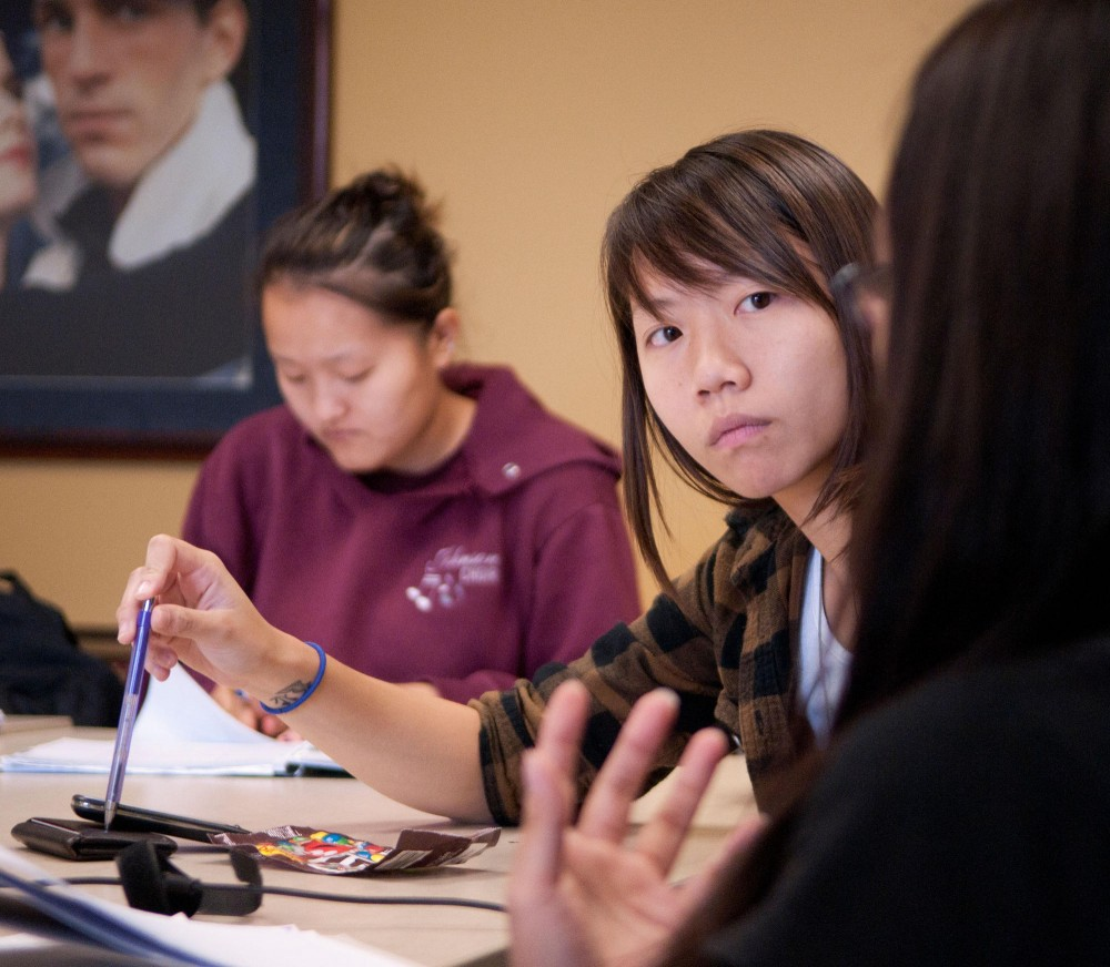 Senior Nguyen Ngoc Pham discusses plans Sunday for an upcoming event being held by the Asian Sorority Interest Group.  The group hopes to establish a sorority on campus that focuses on asian culture and values.