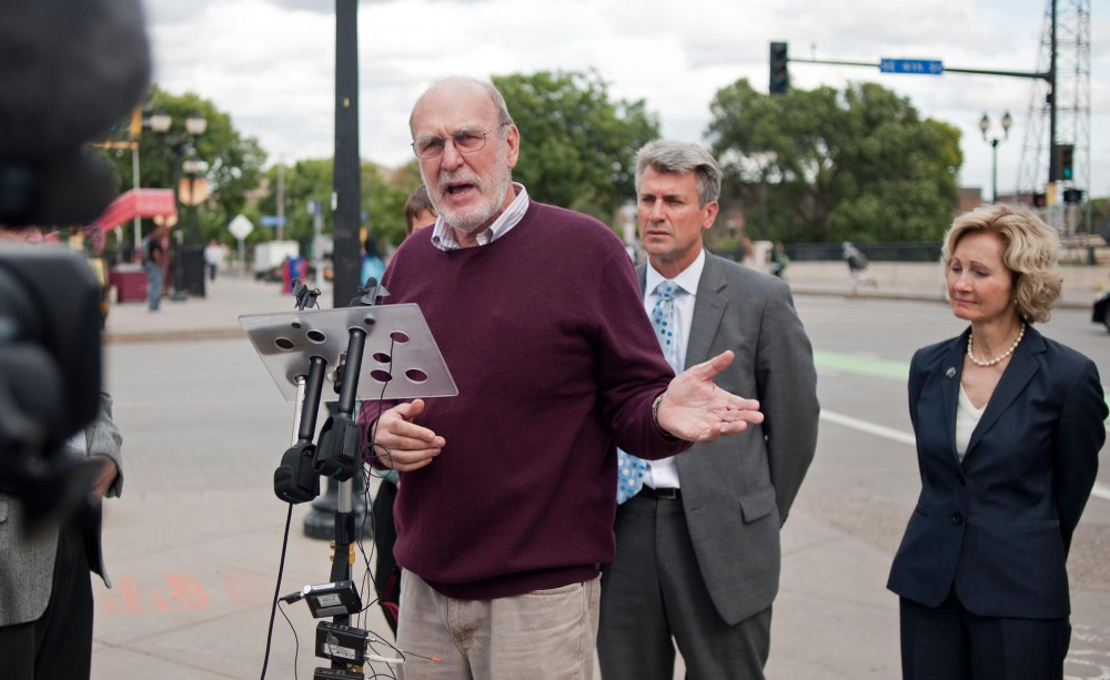 Harry Hill, father of University student who was killed while biking through the intersection of Fourth Street and 15th Ave last April, speaks about risks bikers face when sharing the road on Tuesday at the scene of the accident.  Audrey Hull was struck by a semi truck turning right through the bike lane.  The city recently installed high-visibility green bike lanes along the stretch of 15th Ave.