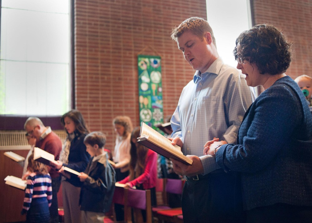 Congregation members Bill and Rosa Summers sing hymns during Sunday worship at University Lutheran Chapel.  Rosa Summers has attended services at ULC since she started school at Hamline University School of Law in 2005.