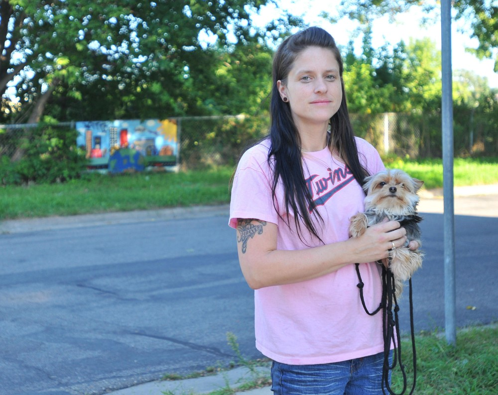Paula Heille and her dog Gizmo live across the street from a site for a proposed dog park in the Beltrami neighborhood.  The empty 3.2 acre lot, currently owned by MNDOT, was the former site of a community garden.