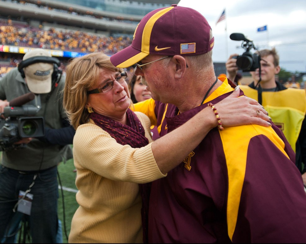 Gophers head football coach Jerry Kill's wife Rebecca embraces him after the game Saturday against Miami Red Hawks at TCF Bank Stadium.