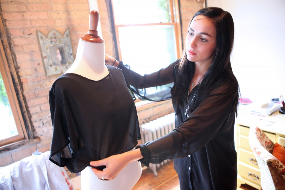 Designer Gina Marie Landes displays one of her shirts on a modeling form Friday afternoon in the studio she shares with her mother in North East Minneapolis.