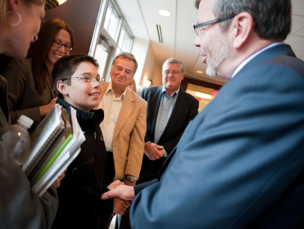 11-year-old PSEO student Lucas Kramer shakes hands with University of Minnesota President Eric Kaler Thursday Sept. 22 in Coffman Union.