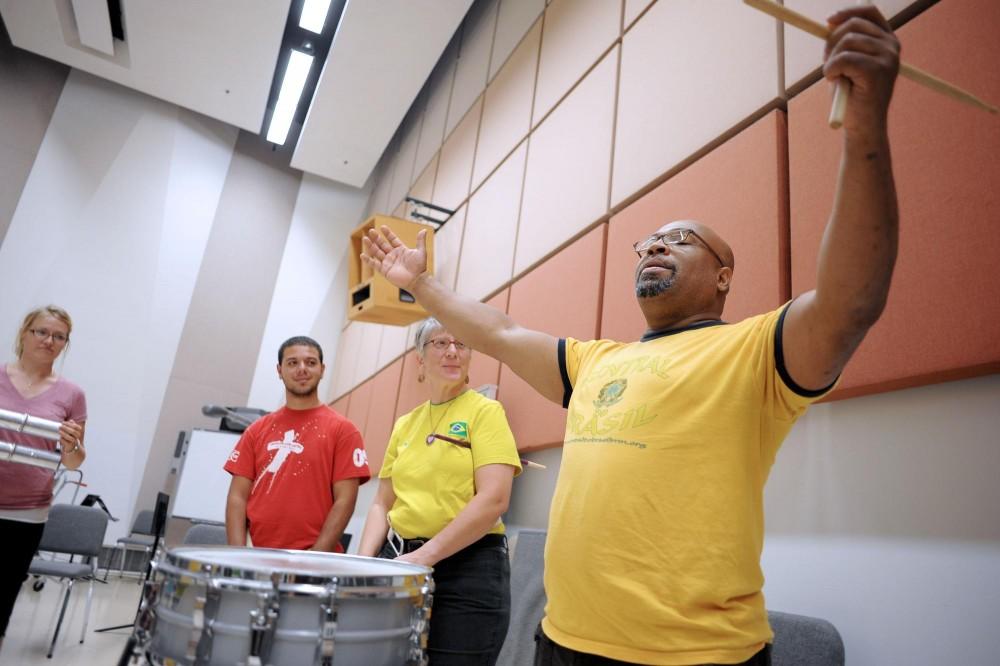 Eliezer Freitas Santos leads a class in Brazilian percussion on Monday in Ferguson Hall.