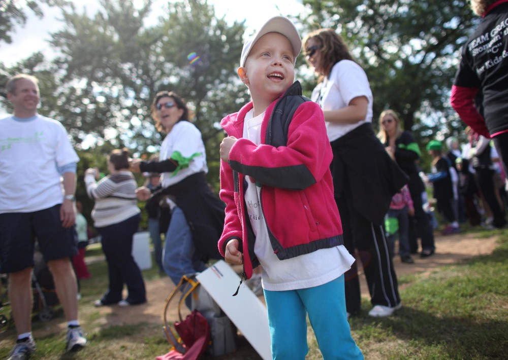 Karolyn Barrett, age 6, learns a dance to warm up for the walk Sunday afternoon at Lake Calhoun for the Cure Search Walk.