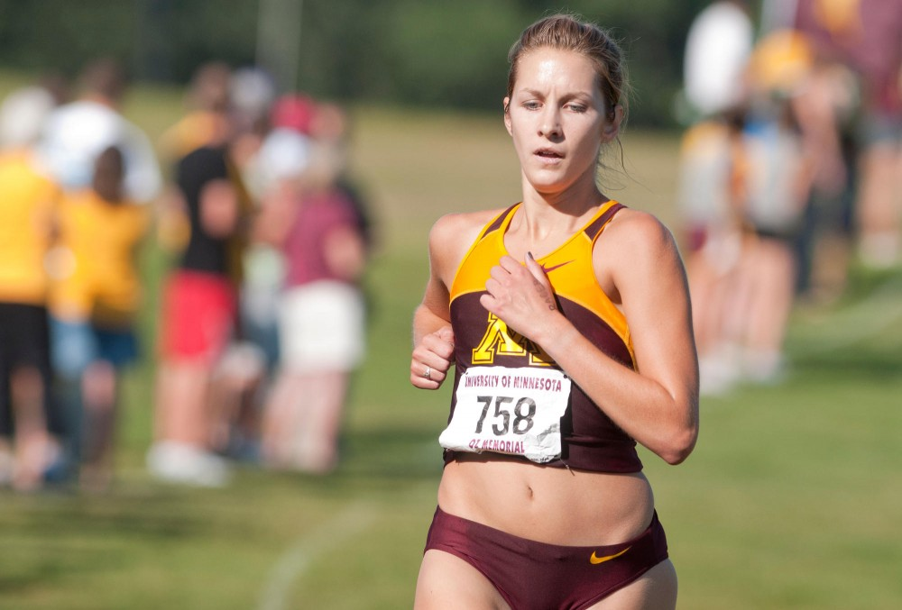 Sophomore Laura Docherty runs in the Oz Memorial Friday Sept. 9 at the Les Bolstad golf course in St. Paul.
