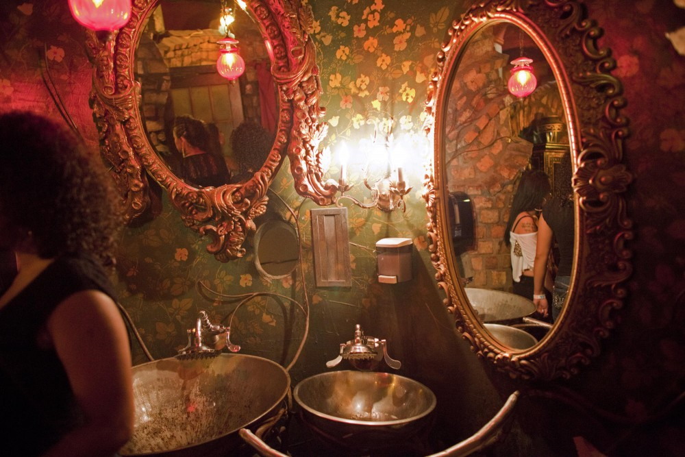 The mirrors enhance the rich ambience of the women's bathroom at Loring Pasta Bar Saturday evening.