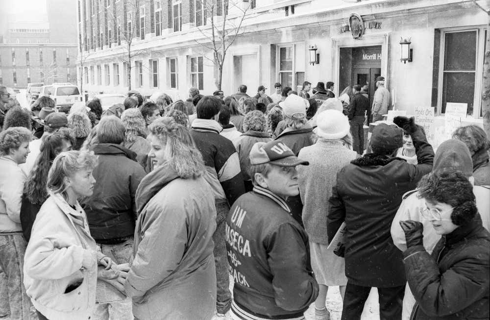 Crowds of Waseca supporters push into Morrill Hall to protest plans to close the campus in Jan. 1991.