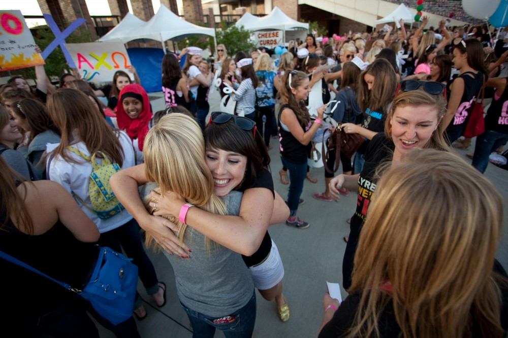 Alpha Chi Omega member Chelsea Rusch welcomes a new recruit with a hug.