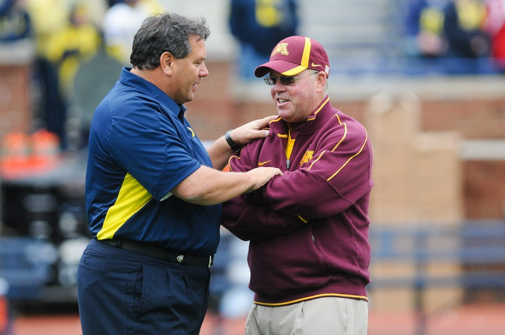 Michigan head coach Brady Hoke and Minnesota head coach Jerry Kill greet each other on the field before kick off Saturday in Ann Arbor, Mich.