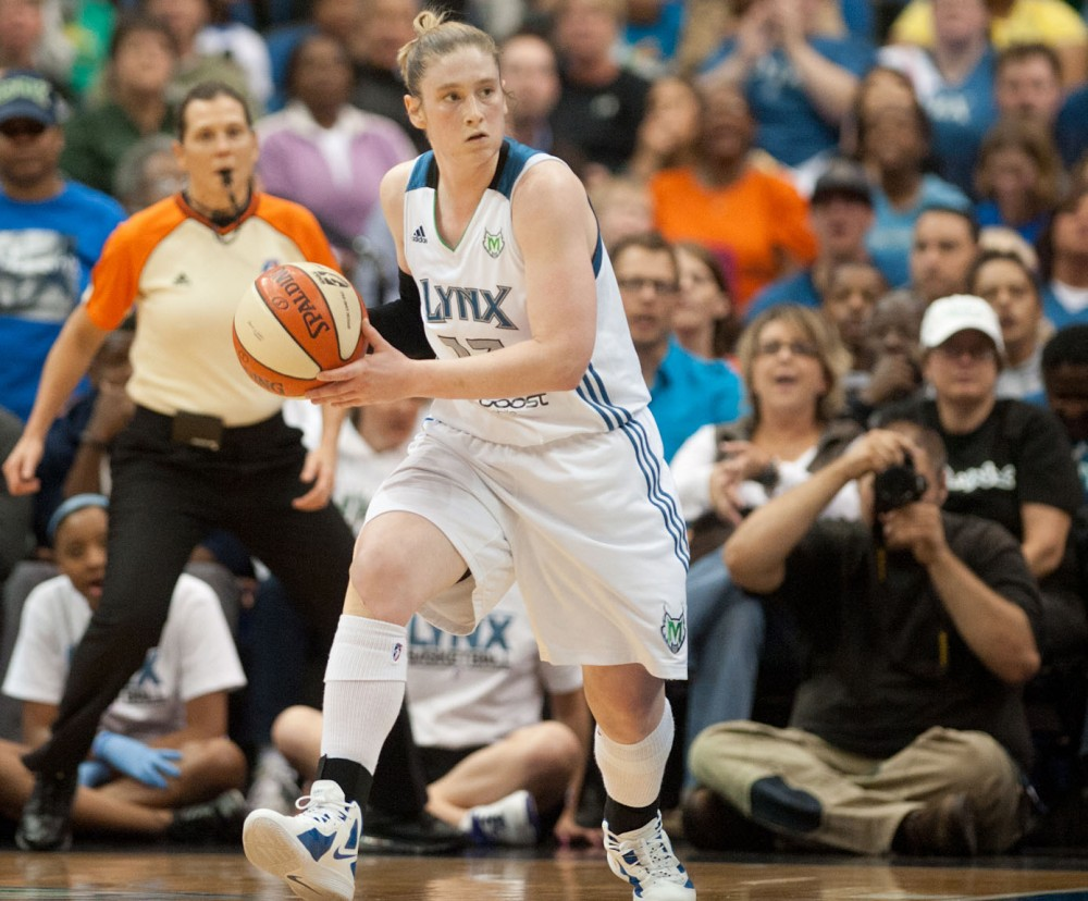 Minnesota Lynx guard Lindsay Whalen greets a fan Tuesday on 7th St  in Downtown Minneapolis.  An estimated crowd of 15,000 people gathered to cheer on the 2011 WNBA champions.