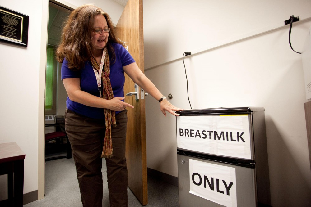 Co-chair of lactation advocacy committee Susan Warfield points out the fridge used to store breast milk outside the lactation room in Appleby Hall Tuesday evening. The room is intended to provide a safe, clean environment for nursing mothers to be able to pump during the day and store it in it's own refrigerator.