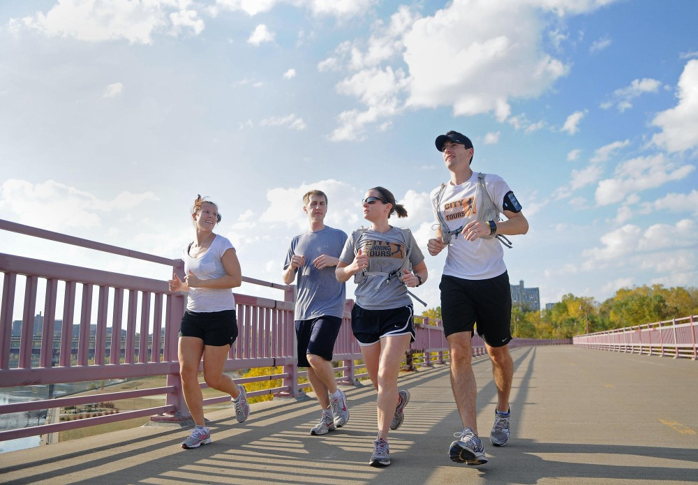 Runners participate Sunday morning in a running tour of the U of M campus.