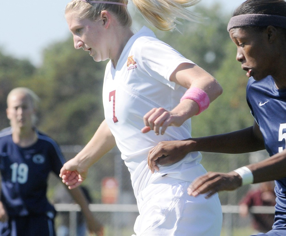 No. 7 of the Minnesota women's soccer team, Allie Phillips, defends the ball against Maya Hayes of Penn State during Sunday's game in Falcon Heights.