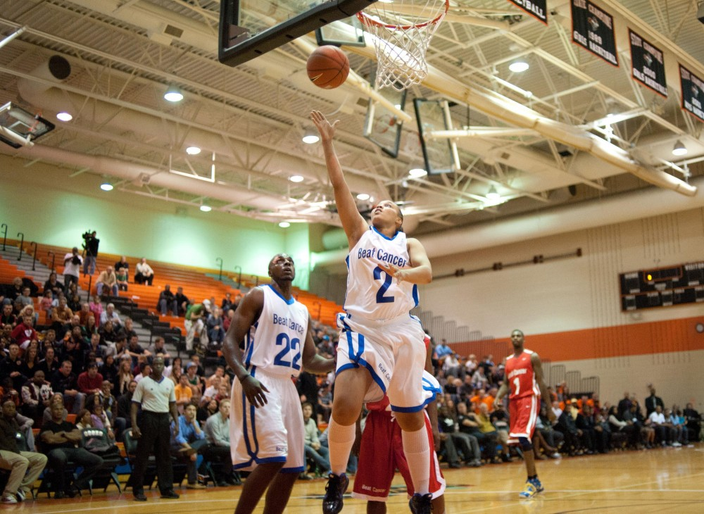 NAME goes up for a basket during a charity game hosted by Timberwolves forward Michael Beasley Friday evening at Osseo Senior High School.  The event featured several NBA players currently locked-out of the professional season.