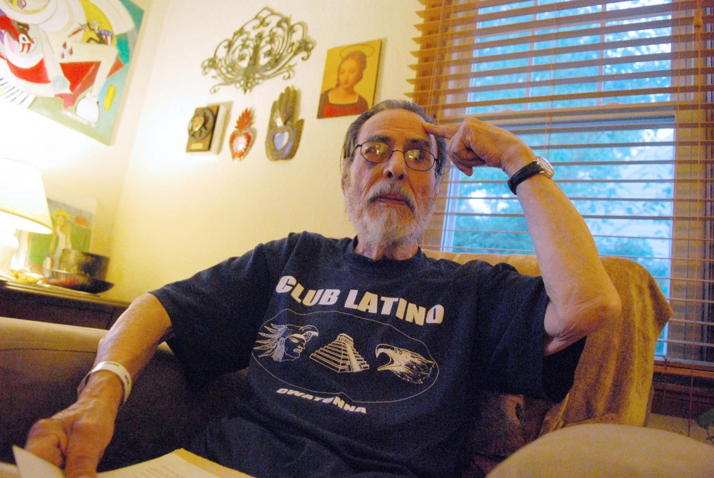 Ray Roybal discusses his involvement with the development of the chicano studies program when he was a student at the University Friday at his home.