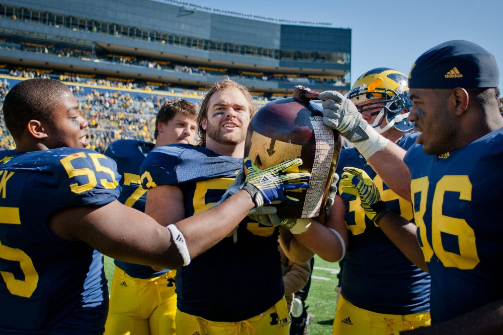 Michigan carries the Little Brown Jug after crushing Minnesota 58-0 Saterday at Ann Arbor, Mich.