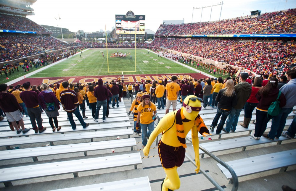 Gophers' fans leave the TCF Bank Stadium during the third quarter of the game Saturday against Nebraska. Husker's fans filled up approximately two-thirds of the seats at the homecoming game.