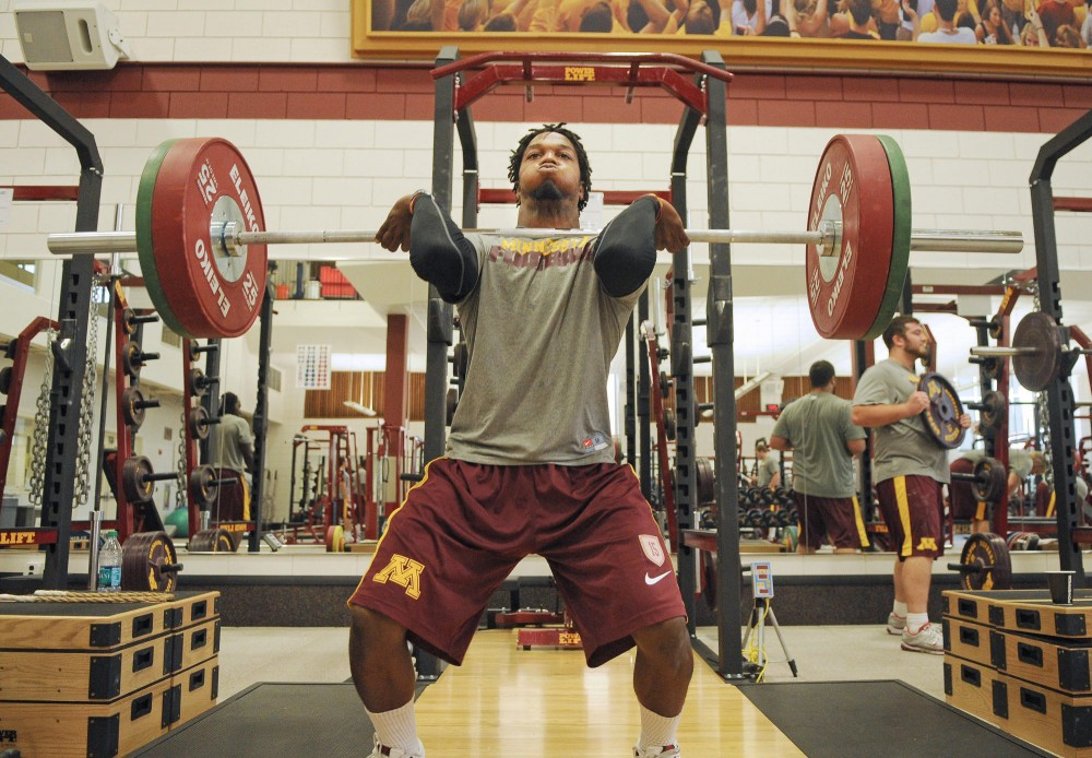 Gophers freshman wide receiver Marcus Jones lifts  weights with the team Friday afternoon in the Gibson/Nagurski Football Practice Facility.