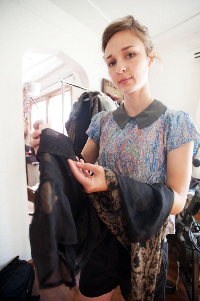 Local designer Danielle Everine showcases her black dress Wednesday at her studio.