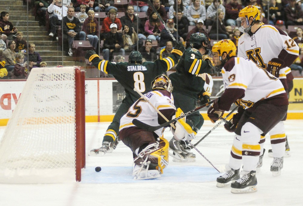Vermont's Sebastian Stalberg scores the Catamounts fifth goal in Sunday's game against Minnesota.  The Gophers recorded their first loss this season versus UVM, 5-4.