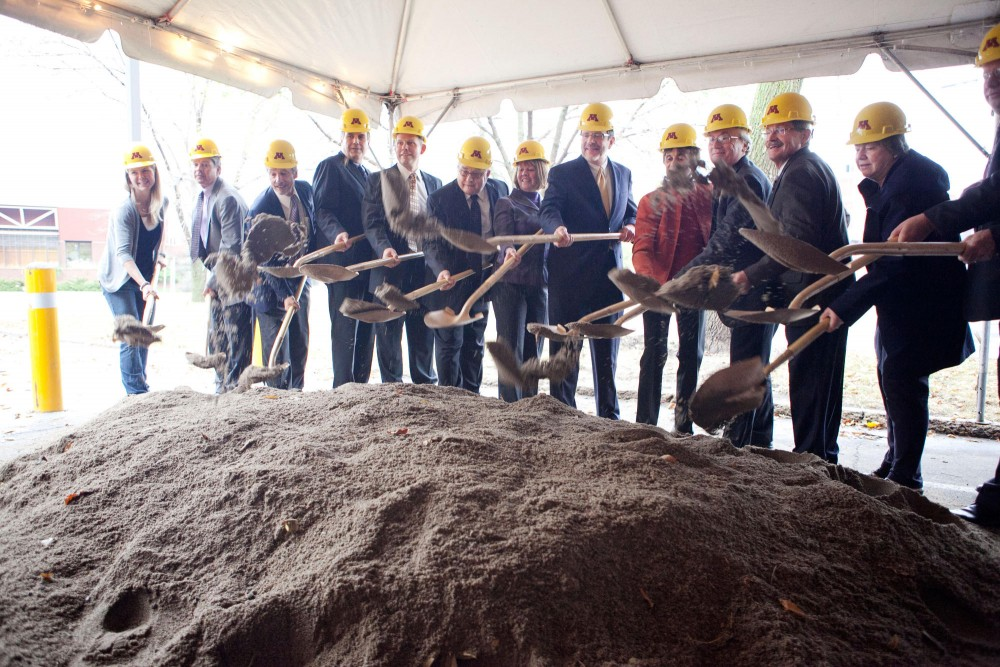 Administration faculty and state officials critical to the success of the new NanoTech building shovel dirt at the groundbreaking ceremony Wednesday afternoon outside Akerman Hall.