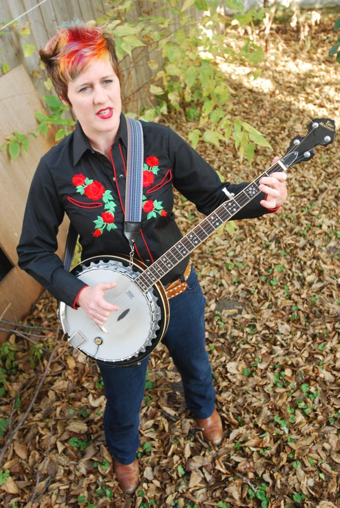 Courtney McLean practices some songs Sunday in preparation for a Punch Out Poetry show on November 2 at the Bryant Lake Bowl.  McLean will be performing with her band, Courtney McClean and the Dirty Curls.
