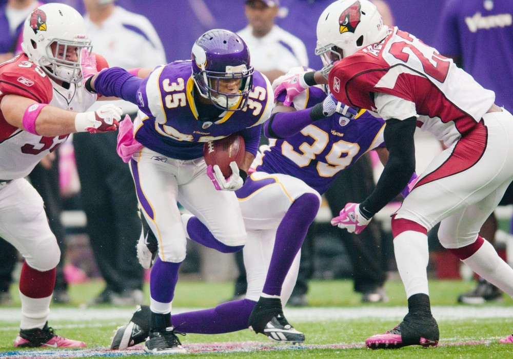 Vikings cornerback Marcus Sherels attempts to break through the Cardinals defense on a kick return Oct. 9 at the Metrodome.  Sherels returned kicks, played cornerback and wide receiver during his time with the Gophers.
