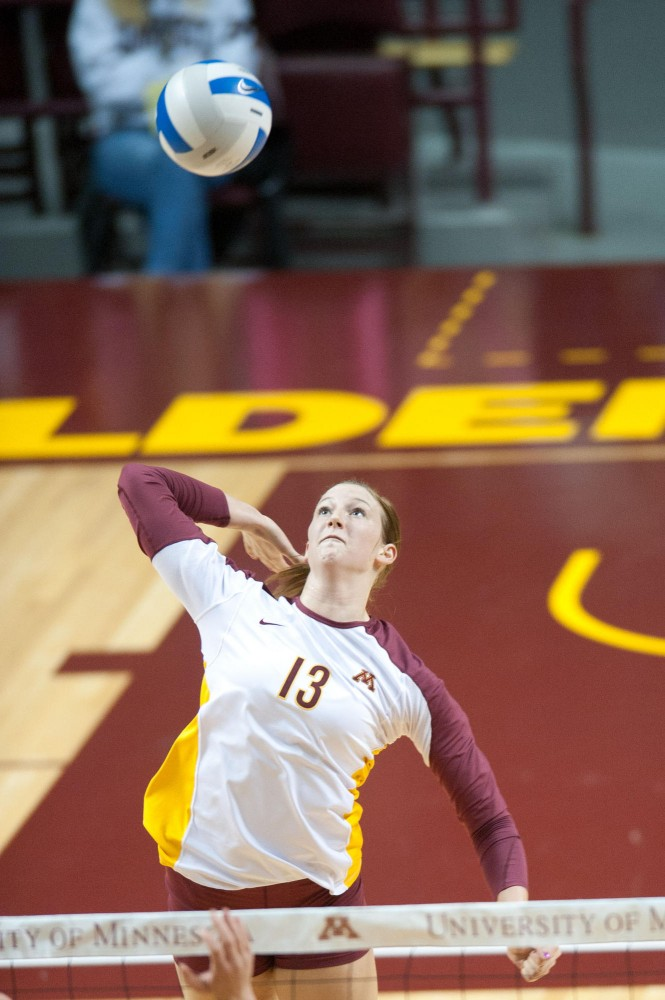 Gophers sophomore outside hitter Ashley Wittman spikes the ball Saturday at Williams Arena. Minnesota lost in five sets to Nebraska