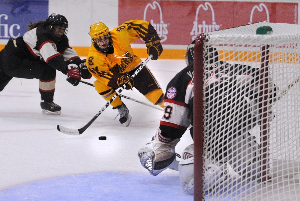 Forward Amanda Kessel charges the goal in Friday's game vs St. Cloud State in Ridder Arena.  The sophomore recorded six points in this weekend's series vs SCSU, including a hat trick in Saturday's game.