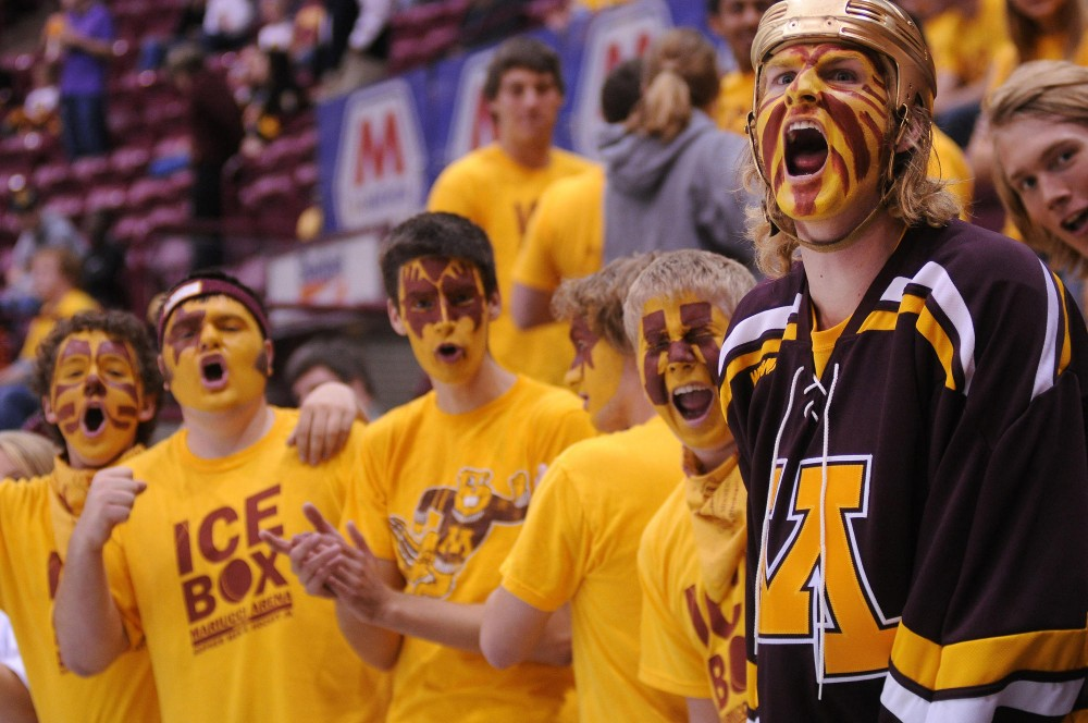 Jeff Atchison, right, screams among painted Gopher fans friday at Mariucci arena.