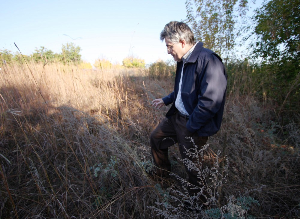 Larry Millett, local author and historian, searches for remnants of the William Merriam Estate which used to occupy this area. This estate, and others in the Twin Cities, were lost due to urban development, which Millett discusses in his new book.