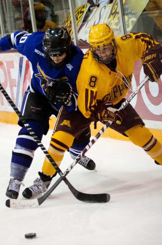 Gophers forward Amanda Kessel fights for the puck Thursday night at Ridder Arena.