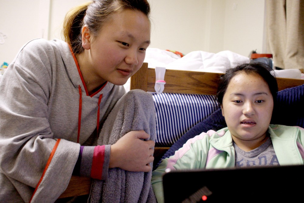 Kaoxue Vang (L), a freshman student at the University of Minnesota, studies with her neighbor Song Thao (R) Tuesday at Comstock Hall in Minneapolis. Vang and Thao live in the Tsev Hmoob (Hmong House) Living Learning Community. Vang is a leader and active member of the Hmong Minnesota Student Association.