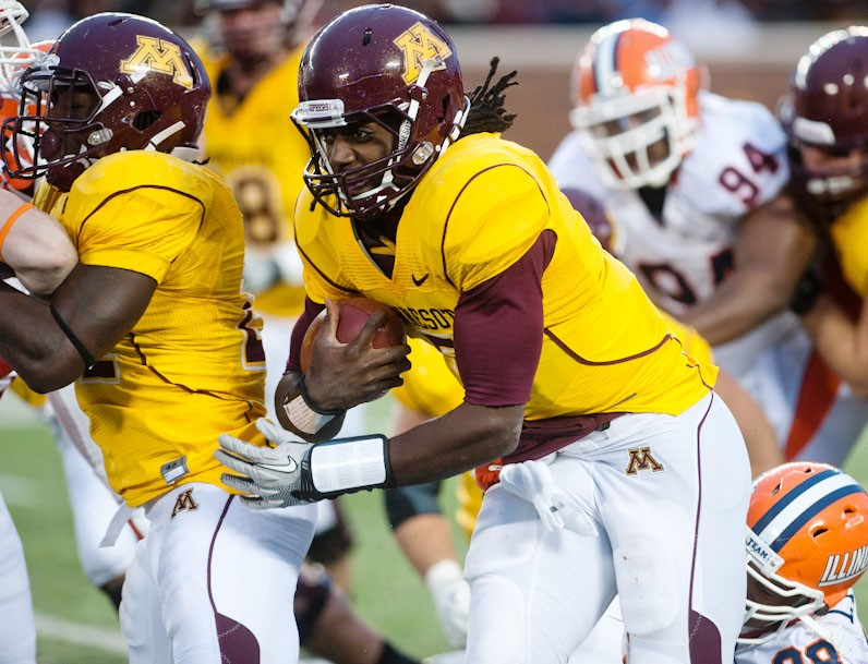 Minnesota quarterback MarQueis  Gray rushes the ball during Saturday's game against Illinois at TCF Bank Stadium.