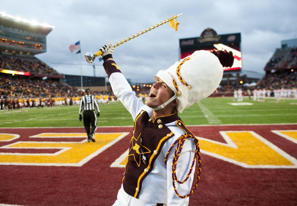 Drum major Brandon Folkes celebrates after Gophers scoring a touchdown during a game against Illinois Saturday at TCF Bank Stadium.
