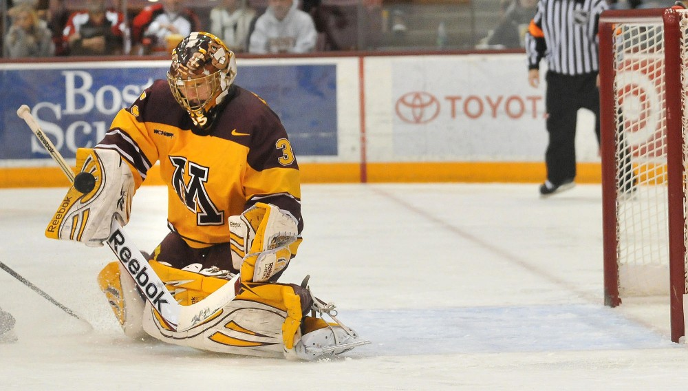 Kent Patterson deflects a shot during Saturday against SCSU in Mariucci Arena.